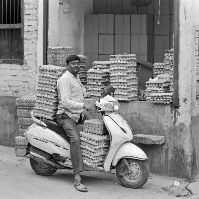 Norman E. Riely - Egg Delivery Man - Varanasi, India 2018 - 20x24 traditional photographic print (silver-gelatin print)